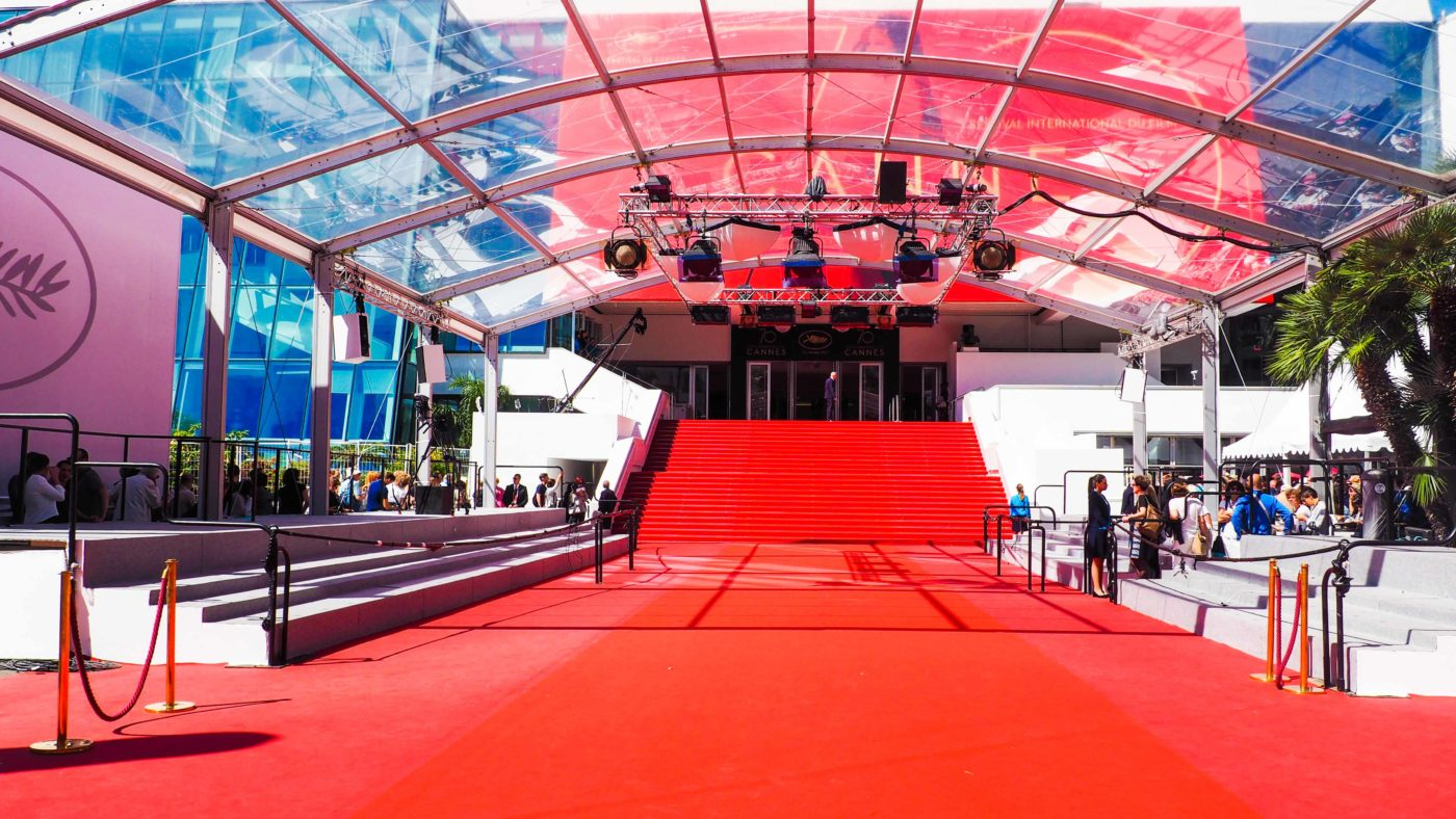 huge red carpet going up stairs outside building for Cannes festival