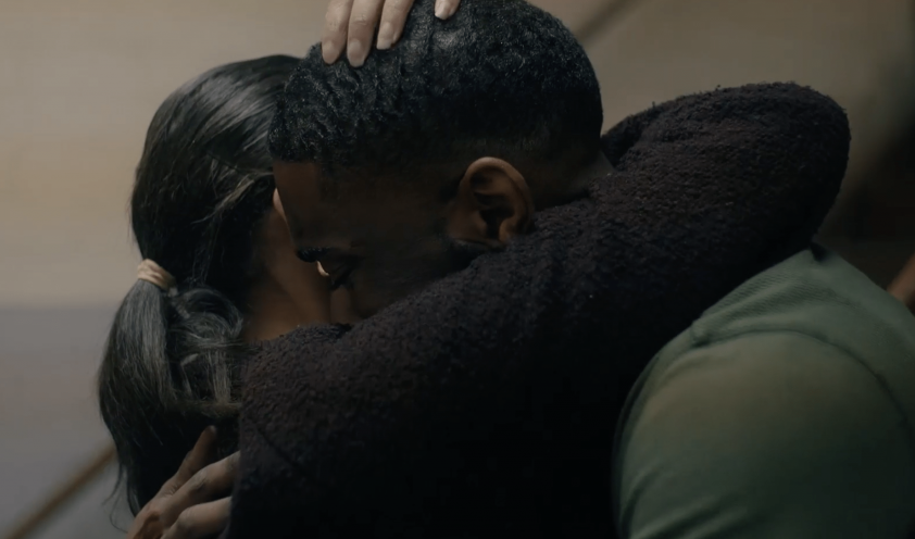 a still from the film 'Navy' by Duaine Carma Roberts, where a woman tightly hugs a man